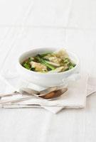 Asparagus soup with prawn wontons