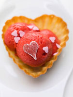Raspberry ice cream with hearts in wafer bowl