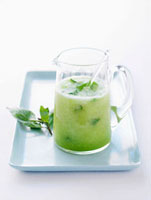 Honeydew melon cocktail with mint in a glass jug