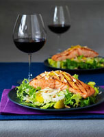 Grilled salmon steaks on a fennel salad
