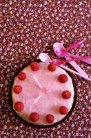 Birthday cake with raspberries