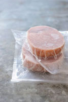 Frozen tuna fillets in plastic packaging