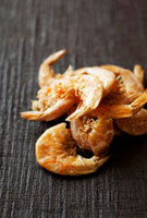 Dried shrimps on a wooden surface