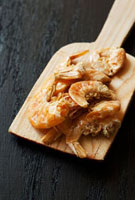 Dried shrimps on a wooden board
