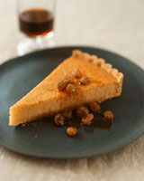 A piece of almond tart with sultanas