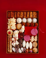 A box of various Christmas biscuits and confectionary