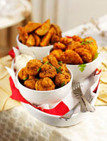 Deep-fried mushrooms and potato wedges for Christmas