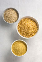 Quinoa and couscous in bowls (overhead view)