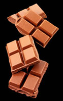 Pieces of chocolate on a black background