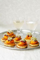 Blinis with carrot butter and beansprouts