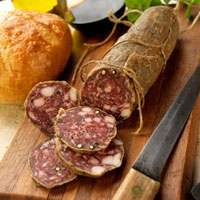 Sliced Tuscan Salami on Cutting Board with Knife; Bread