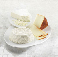 Three Assorted Cheeses on White Dishes