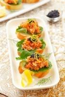 Tapas with salmon tatar and black caviar