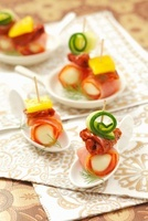 Mozzarella balls wrapped in ham, dried tomatoes and gherkins