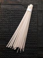 A bunch of udo noodles on tea brick