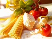 An arrangement of spaghetti, tomatoes, Parmesan and basil