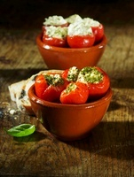 Cherry tomatoes stuffed with a herb and cream cheese filling