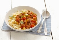 Conchiglie with minced meat ragout and peppers
