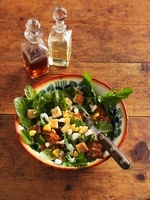 Dandelion salad with egg and bacon