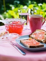 Buttered bread with pink redcurrant jelly