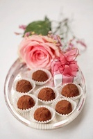 Truffle pralines on a silver tray decorated with flowers