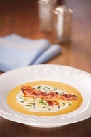 Cream of pumpkin soup with fried bacon