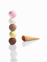A stack of ice cream scoops and a cone