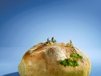 A bread roll with cyclists figures on top