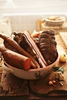 Various types of meat (bacon, legs, hard sausage)