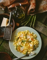 Tagliatelle with green asparagus, smoked fish and Parmesan