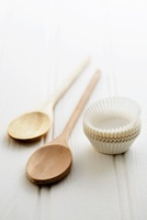 Paper cases and wooden spoons