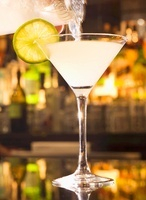 Pouring a Lemon Drop Martini into a Glass from Pitcher; On B