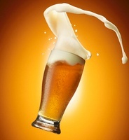 Beer foam streaming out of a glass