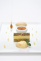 Pistachio dacquoise with almond ice cream and cream brulee