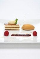 Vanilla mousse in puff pastry with caramel ice cream and ras