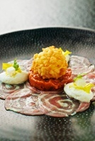Veal roulade carpaccio with kohlrabi mousse gnocchi and crou