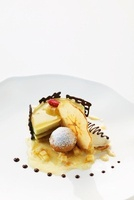 Apple mousse tartlet with Calvados jelly, apple ice cream an