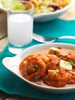 Prawns with feta in tomato sauce with a glass of ouzo (Greec