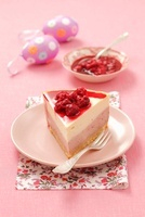 A slice of cheesecake with raspberries for Easter