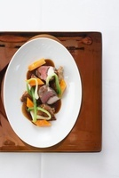 Saddle of wild hare with spicy foam and vegetables