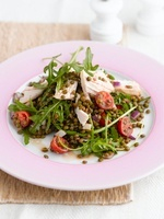 Lentil salad with chicken, rocket and cherry tomatoes