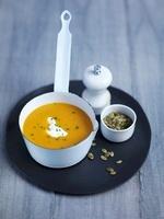 Pumpkin and apple soup with pumpkin seeds