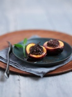 Roasted peaches filled with a rum and chocolate mixture