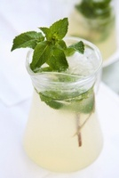 Peppermint sprigs in a glass carafe