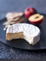 Camembert, crisp breads and plums