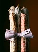 Various salamis tied with a shirt