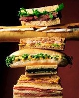A stack of various sandwiches