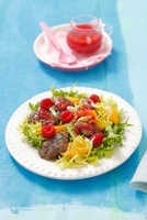 Frisee salad with chicken liver, orange, raspberries and ras