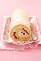 Sponge roll with mascarpone and pomegranate seeds