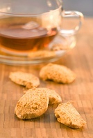 Biscuits with a cup of tea in the background